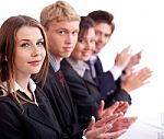 colleagues-applauding-during-a-business-meeting-10038964