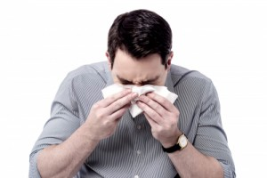 sneezing 300x200 Tis the Season For Sickness Absence
